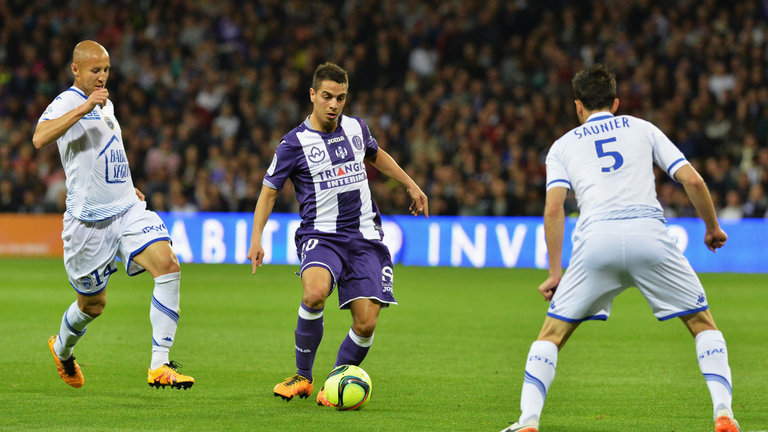 Sevilla signed Toulouse forward Ben Yedder (centre) on five-year deal